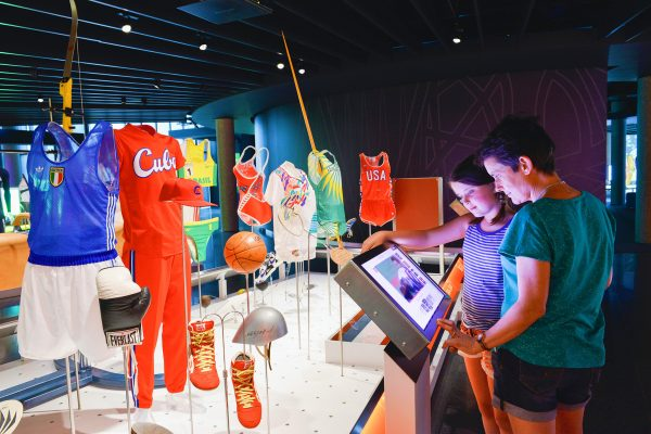 "The Olympic Museum Lausanne, 2015 - Interior view. Permanent exhibition. Visitors in front of the touchscreens, in the area ""The Olympic Games"", at the Level 0."