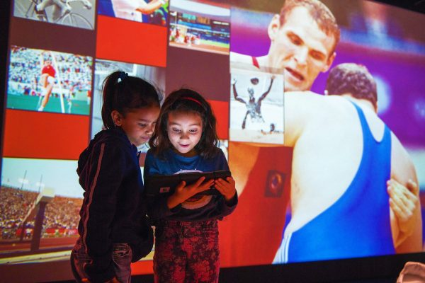A school class visiting the Olympic Museum, Lausanne, 2019 - Self-guided tour of the permanent exhibition with a digital tablet.