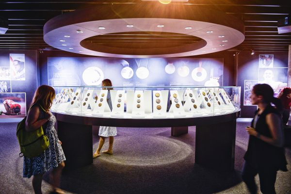 "The Olympic Museum Lausanne, 2015 - Interior view. Permanent exhibition at the Level -1. Some visitors in the area ""The Medals""."